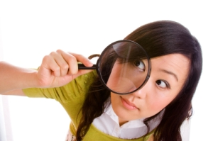 Top10_printers_business_girl_magnifying_glass